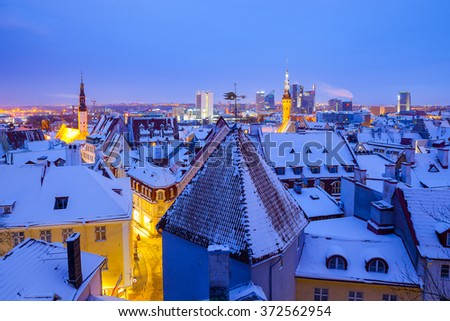 Panoramic view of old part of Tallinn in winter. Town hall and churches spires - stock photo