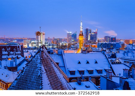 Panoramic view of old part of Tallinn in winter. Town hall and modern business buildings - stock photo
