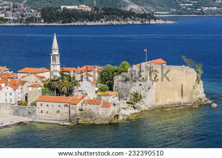 Panoramic view of Old town Budva: Ancient walls and red tiled roof. Montenegro, Europe. Budva - one of best preserved medieval cities in the Mediterranean and most popular resorts of Adriatic Riviera.