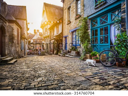 Panoramic view of old town in Europe in beautiful evening light at sunset with retro vintage Instagram style filter and lens flare effect - stock photo