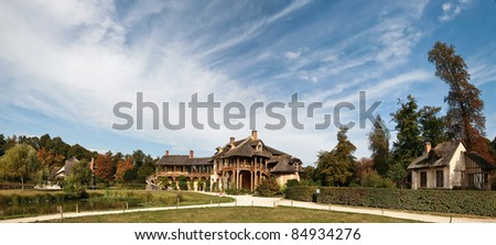 Panoramic view of old Wooden gallery of the Queen's house in Marie-Antoinette's estate. Versailles. - stock photo