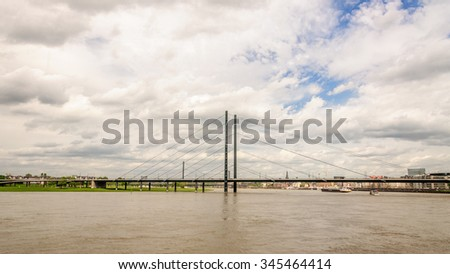 Panoramic view of one of seven bridges across the Rhine. Located in close proximity to the historical part of the city and promenade of Dusseldorf, Germany - stock photo