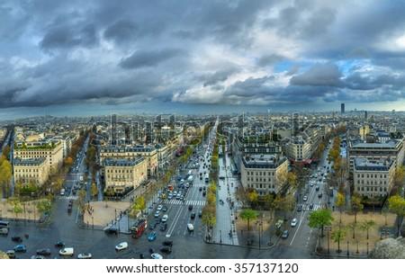 Panoramic view of Paris from the Arc de Triomphe. Autumn. Rain. Sun. - stock photo