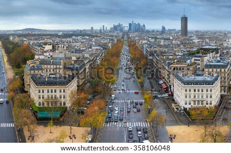 Panoramic view of Paris from the Arc de Triomphe. Direction of Defense. Autumn. Rain.