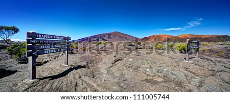Panoramic view of Piton de la Fournaise volcano with sign in foreground, Reunion National Park, Reunion Island. - stock photo
