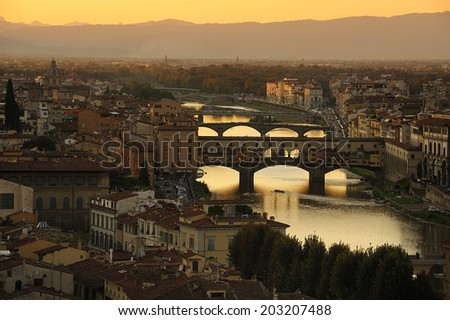 Panoramic view of Ponte Vecchio (Old Bridge) at sunset, Florence, Italy