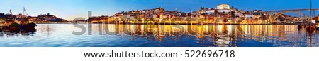 Panoramic view of Porto at twilight with reflection in Douro river. Portugal