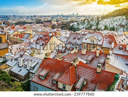 Panoramic view of Prague roofs from the Prague Castle in the evening, Czech Republic - stock photo