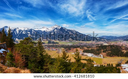 Panoramic view of Reutte with Alps and clous, high resolution image. Alps, Tyrol, Austria. - stock photo