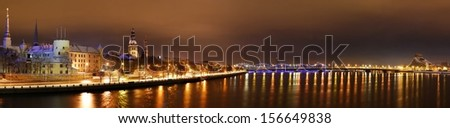 Panoramic view of Riga by night - stock photo
