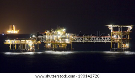 Panoramic view of rigs in a large oil-field