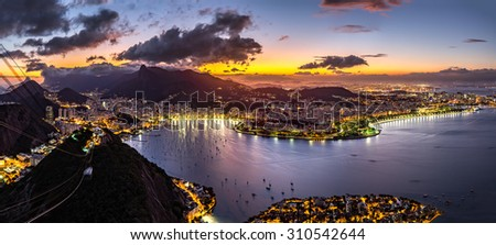 Panoramic view of Rio de Janeiro by night, as viewed from Sugar Loaf peak. - stock photo