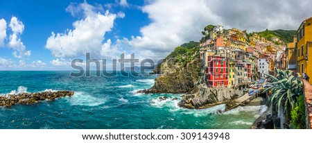 Panoramic view of Riomaggiore, one of the five famous fisherman villages of Cinque Terre in Liguria, Italy - stock photo