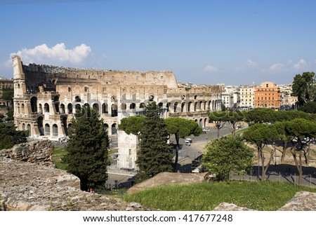 Panoramic view of Rome old city: Colosseum and Arch of Titus - stock photo