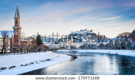 Panoramic view of Salzburg skyline with Festung Hohensalzburg and river Salzach in winter, Salzburger Land, Austria - stock photo