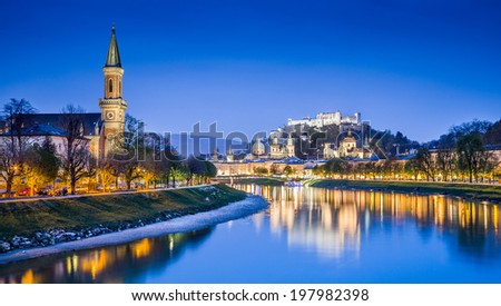 Panoramic view of Salzburg skyline with Festung Hohensalzburg and Salzach river at blue hour, Salzburger Land, Austria - stock photo