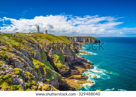 Panoramic view of scenic coastal landscape with traditional lighthouse at famous Cap Frehel peninsula on the Cote d'Emeraude, commune of Plevenon, Cotes-d'Armor, Bretagne, northern France - stock photo