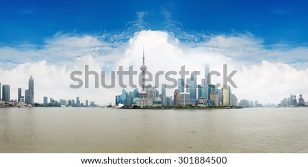 panoramic view of shanghai skyline with huangpu river  - stock photo