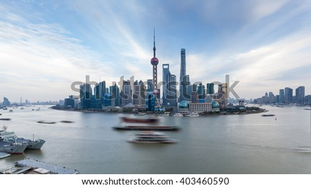 panoramic view of shanghai skyline with huangpu river at dusk - stock photo