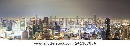 Panoramic view of skyline at night in Osaka, Japan - stock photo