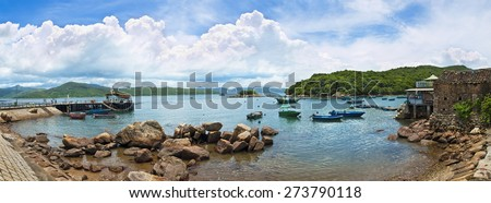 panoramic view of small fishing village near Hong Kong on sunny day - stock photo