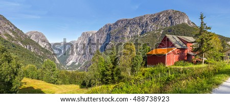 Panoramic view of Stalheim with a red barn in the foreground, Norway