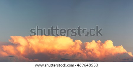 Panoramic view of storm clouds at sunset