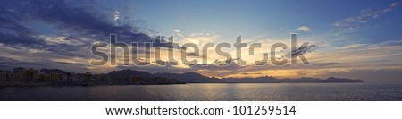 Panoramic view of sunset at Mediterranean sea on Sicily. - stock photo