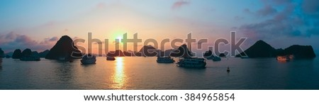 Panoramic view of sunset in Halong Bay, Vietnam, Southeast Asia - stock photo