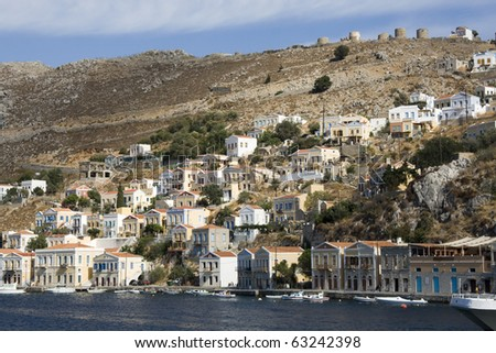 Panoramic view of Symi - Greece  Symi has the most beautiful harbor in Greece. Houses, some white, some pastel yellow with Neo-Classical pediments - Dodecanese Islands