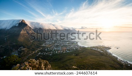Panoramic view of table mountain and camps bay in Cape Town, South Africa at sunset. - stock photo