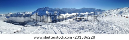 panoramic view of the Alps and ski slope - stock photo
