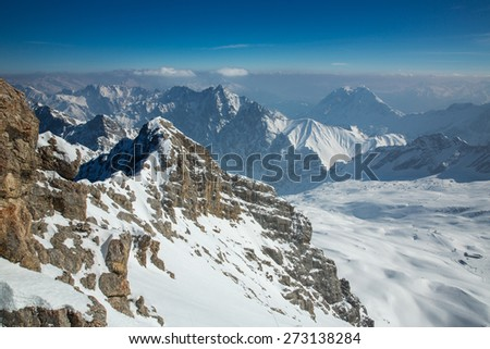 Panoramic view of the Alps from the Zugspitze peak. - stock photo