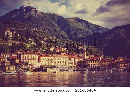 Panoramic view of the beautiful old Italian town of Bellagio, Lake Como Italy. European travel, vacation, and life style concept. Soft red vintage post processed - stock photo