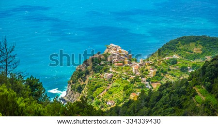 Panoramic view of the beautiful town Manarola, one of the five famous fisherman villages of Cinque Terre with dramatic cloudscape in Liguria, Italy - stock photo