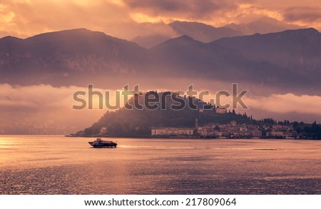 Panoramic view of the beautiful town of Bellagio, Lake Como Italy. Sunset. European vacation, living life style, architecture and travel concept. - stock photo