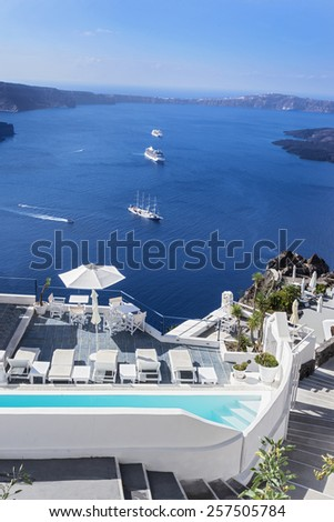 Panoramic view of the Caldera in Santorini Several cruise ships arrive to the spectacular island of Santorini in the Cyclades  - stock photo