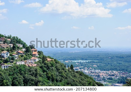 Panoramic view of the city of Como over the Lake Como, Lombardy, Italy. - stock photo