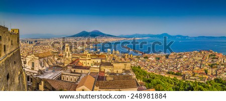 Panoramic view of the city of Napoli (Naples) with famous Mount Vesuvius in the background in golden evening light at sunset, Campania, Italy - stock photo