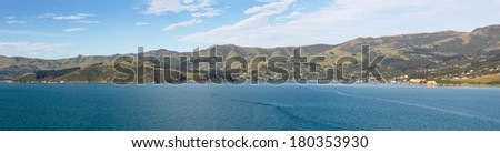 Panoramic view of the coastline around Akaroa harbour near Christchurch on South Island of New Zealand - stock photo
