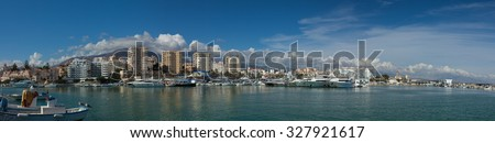 Panoramic view of the Harbour at Estepona, Spain with mountains and bright blue sky