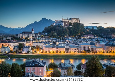 Panoramic view of the historic city of Salzburg with Hohensalzburg Fortress at dusk, Salzburger Land, Austria - stock photo