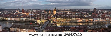 Panoramic view of the historic city of Wurzburg at night with Alte Mainbrucke, region of Franconia, Northern Bavaria, Germany - stock photo