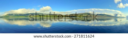 panoramic view of the Mountains and McDonald lake in Glacier National Park, Montana in summer - stock photo