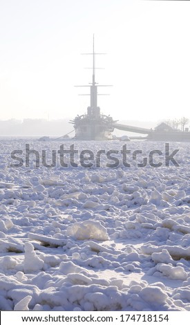Panoramic view of the Neva River, covered with ice and the Cruiser Aurora. Saint-Petersburg. Russia - stock photo