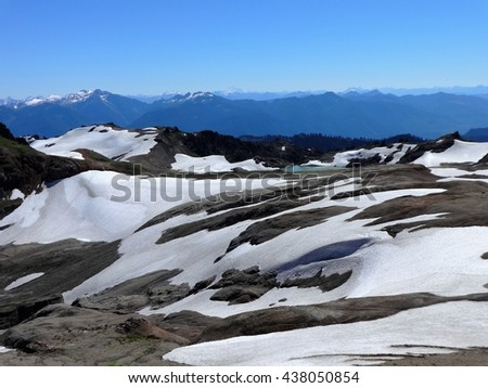 Panoramic view of the North Cascades and snow fields - stock photo