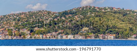 Panoramic view of the residential houses sailing Bosphorus.