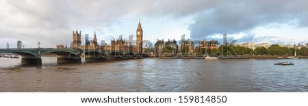 Panoramic view of the River Thames, Houses of Parliament and the Big Ben, Westminster Bridge in London - stock photo