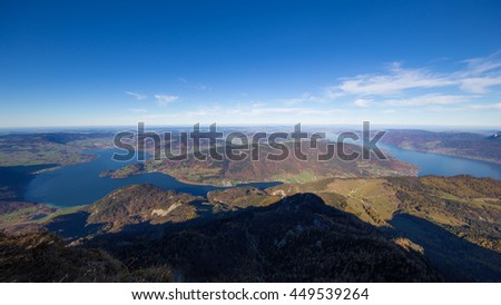 """Panoramic view of the """"Salzkammergut"""" region of Austria, lake """"Mondsee"""" and lake """"Attersee"""" seen from mount """"Schafberg"""" (Salzburg, Austria). - stock photo"""