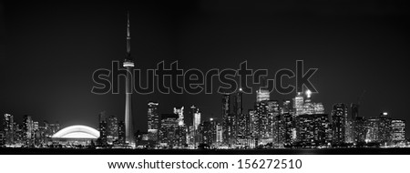 Panoramic view of the spectacular Toronto skyline during nightime. Beautiful lights of the city. Landmarks visited by tourist everyday of the year - stock photo